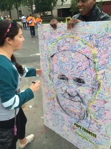 A representative from the National Air and Space Museum in D.C walked around with a portrait of Pope Francis  and encouraged individuals (myself included) to sign it in honor of his visit.